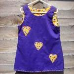 Girls purple pinafore heart..